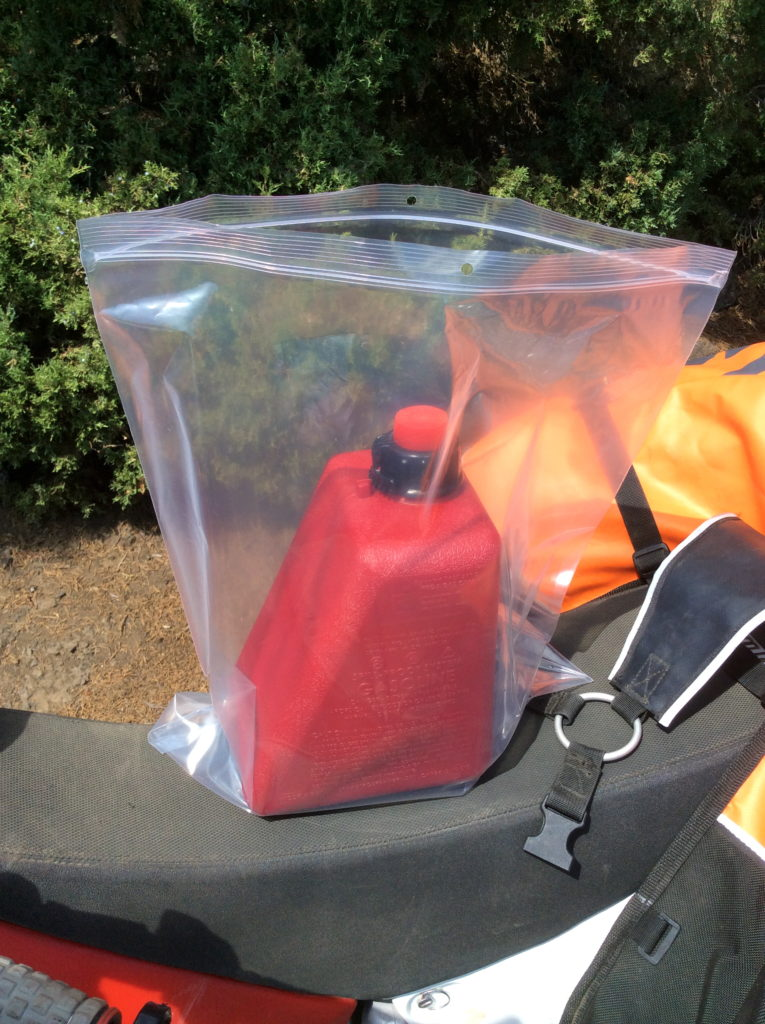Plastic bag contains gasoline smell when packing Reda can inside Coyote Saddlebag